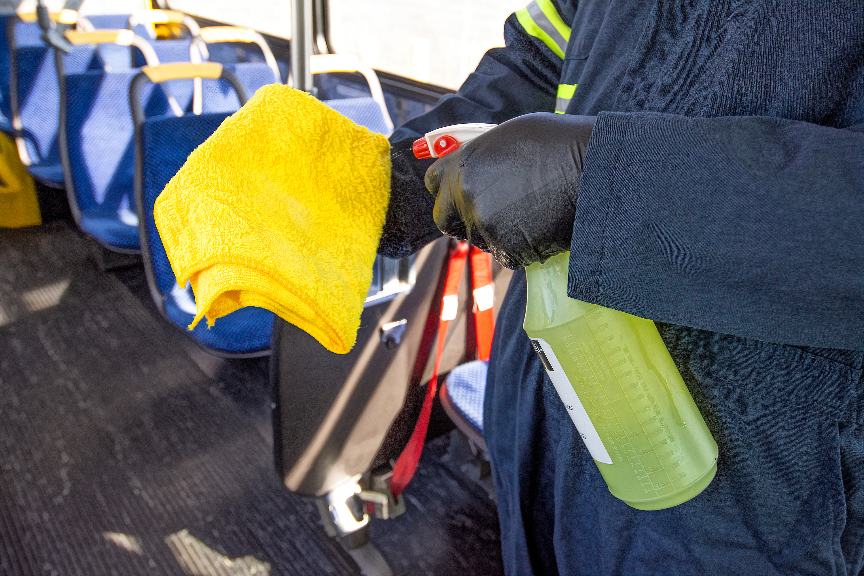 Cleaning high-touch areas on the bus
