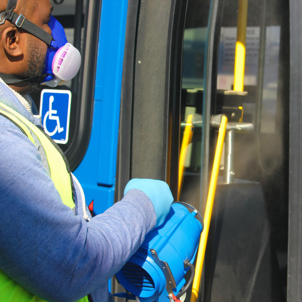 Disinfecting buses.